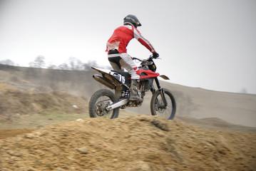 Motocross biker jumping