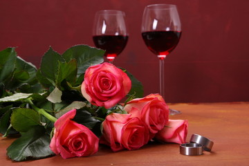 wedding ring, roses and red wine