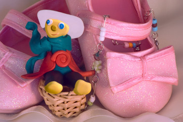 Plasticine toy and children's brilliant pink shoes