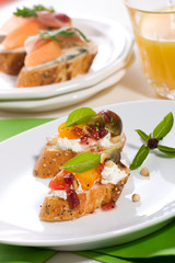 Prosciutto and blue cheese canapes