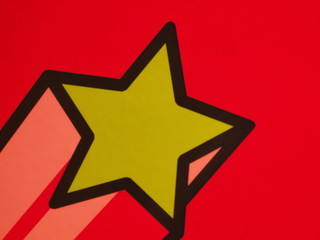 Yellow star on red background with black border