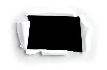 image d'un trou dans une feuille de papier pour message