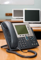Modern digital phone on office table