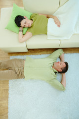 Couple sleeping on couch