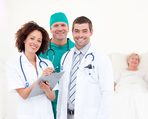 Surgeon with doctors looking after a senior patient