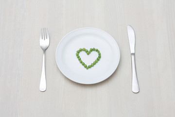 Peas in a heart-shape on a plate