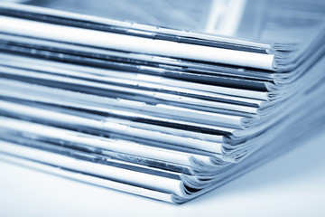 stack of magazines toned blue isolated