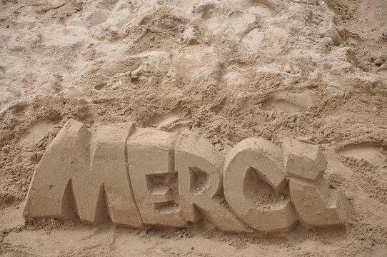 sculture sur sable, merci