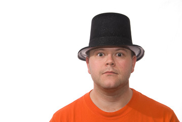Man in Hat Looks At You with Goofy Expression