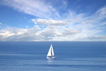 Lonely white sail at infinite ocean