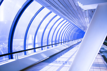 Blue glass corridor in tube