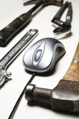 computer mouse and old tools