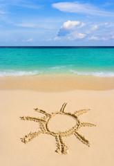 Drawing sun on beach
