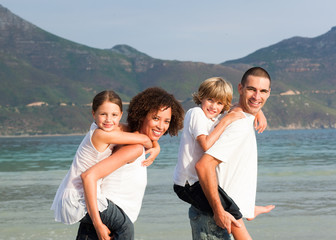 Happy family playing on the beach