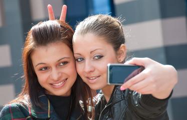 Two happy girls make self-portrait