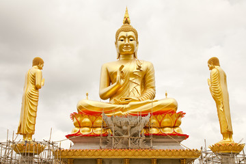 Big gold color Buddha images under construction