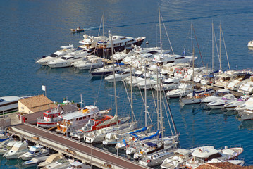 Pier with white yachts
