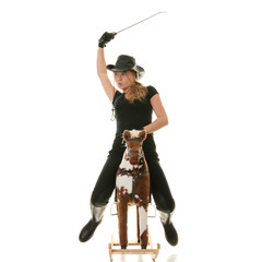 Cowgirl (jockey) race on hobbyhorse