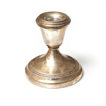 silver candle stick holder isolated on a studio background.