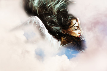 fantasy woman flying through the  clouds