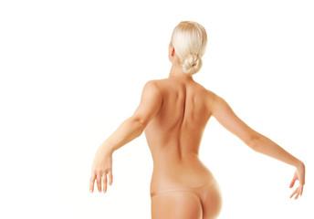 Beautiful young woman dancing naked