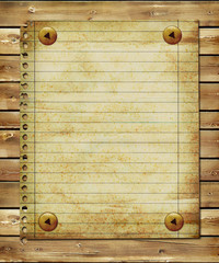 old blank page over wooden planks