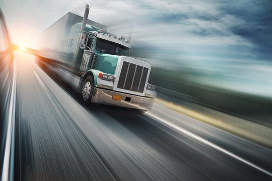 American truck speeding on freeway. Blurred motion.