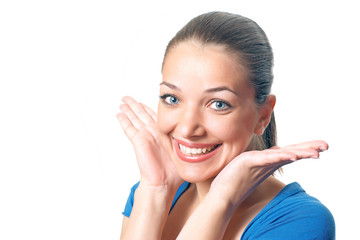 Young pretty woman with palms near face in blue shirt. Isolate
