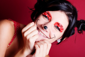 Minnie mouse make-up on a smiling girl