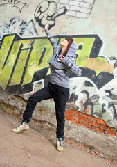 stylish and cool hip hop style dancer posing