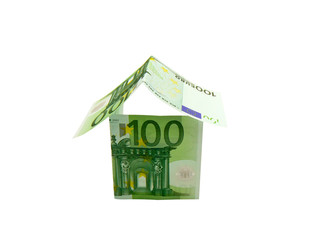 House made of european money isolated on white background
