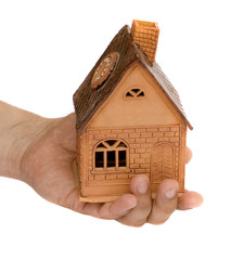 Small house in a hand