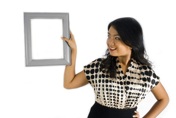 Asian Female looking at photo frame