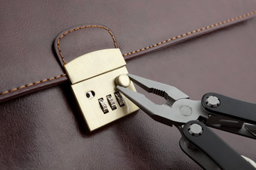 Opening of a brown case with a coded lock