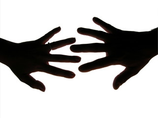 Man and woman hands silhouette