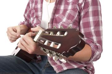 Guitarist playing in closeup