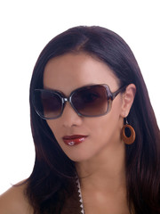 Portrait young hispanic woman wearing sunglasses