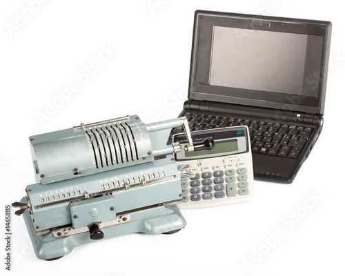 Adding machine, modern calculator and notebook