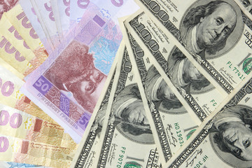The Ukrainian and American money is a background,