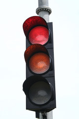 View of a traffic lights - red and orange lit