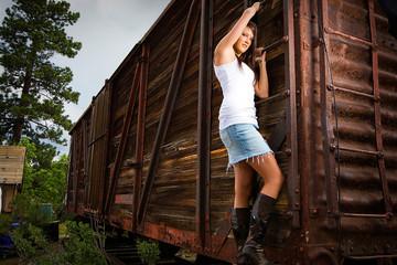 beautiful girl hanging onto train