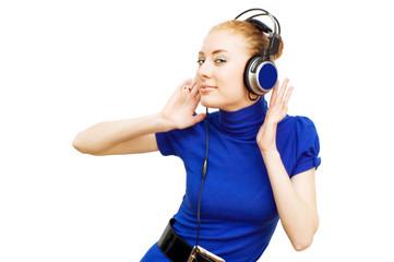 Redhead woman with headphones enjoying music