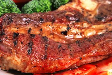roast juicy fat steak and hot sauces