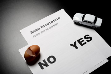 Auto insurance decision and broken egg