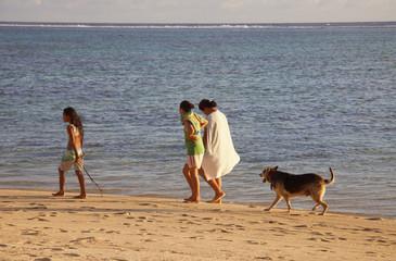 Polynesian Girls walking on the Beach