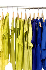 A rack of colorful shirt