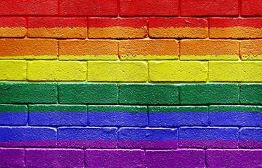 Rainbow flag on brick wall