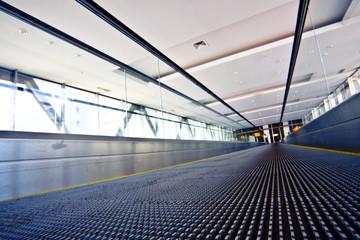 Camera lay on escalator view in violet corridor