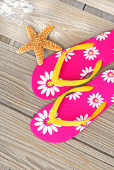 Flip flops and starfish on dock