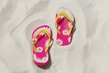 flip flops in beach sand